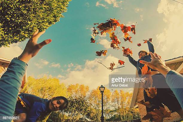Kids playing with autumn leafs in the home yard.