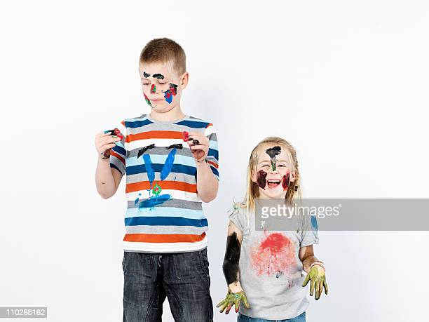 Kids playing with finger paint