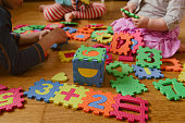 kids playing with number puzzle, education concept