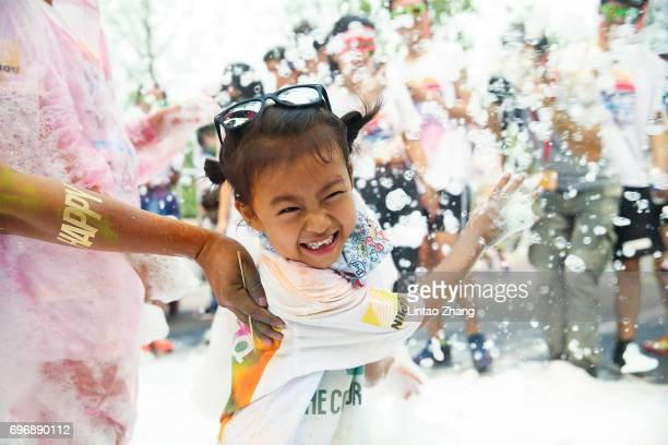 A kids playing with soap bubbles during the Colour Run at the Beijing International Garden Expo park on June 17 2017 in Beijing China