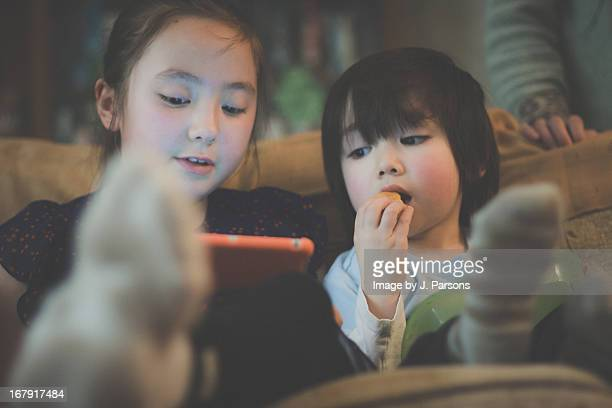 Kids playing with tablet