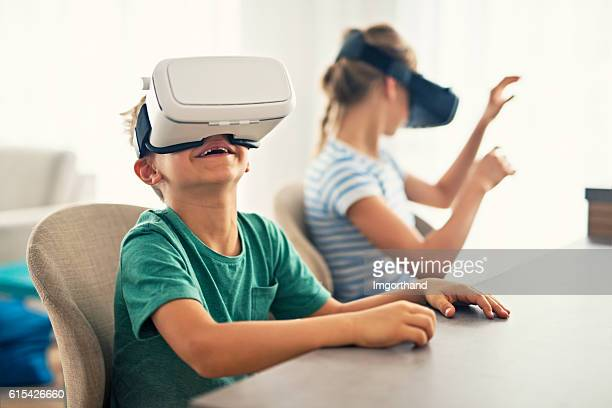 Kids playing with virtual reality headset