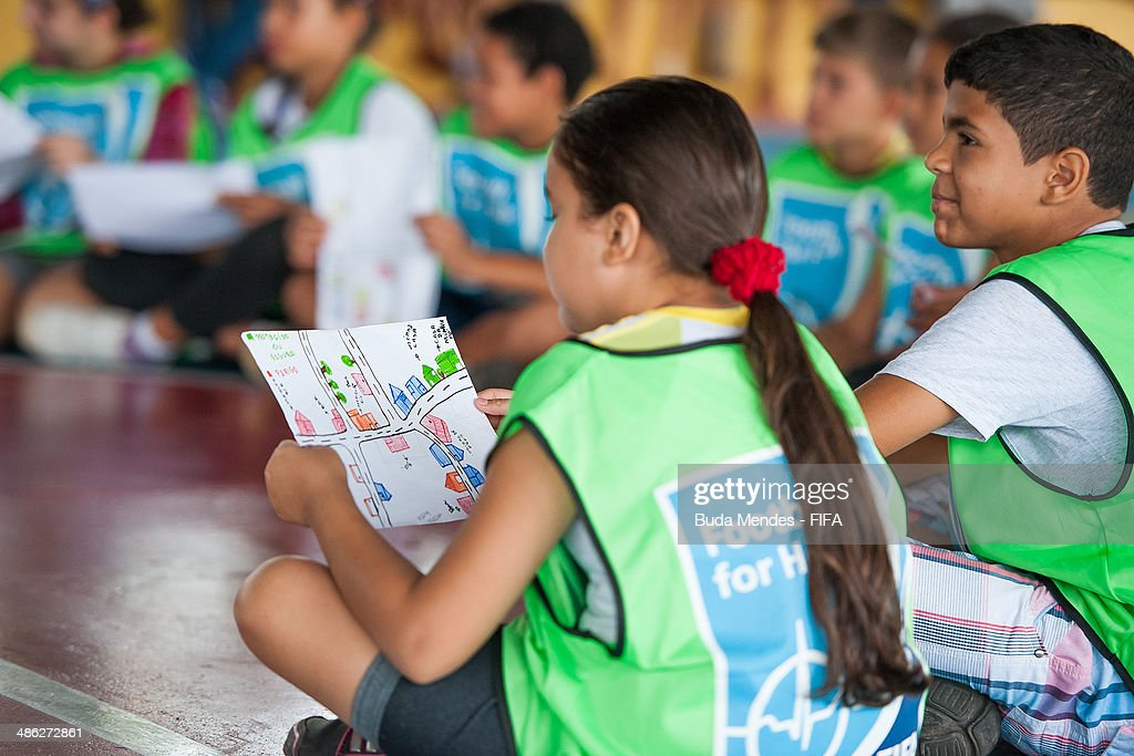 Kids practice exercises during visit a FIFA 11 for Health Program as part of the 2014 FIFA World Cup Host City Tour on April 23, 2014 in Cuiaba, Brazil