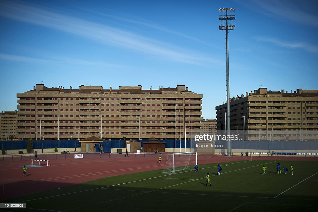 Kids practice their football skills on a training ground backdropped by the many empty newly built apartment buildings on October 22, 2012 in Sesena, Spain. With a housing backlog of more than 1.2 million unsold newly build homes, banks in Spain have recenlty started to sell their real estate assets with discounts, some upto 80 percent, slashing prices to a level not seen for over 20 years. With morgages of 100 percent, some experts worry that mistakes from the past are repeated again.