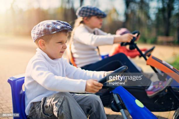 Kids preparing to race in small cars in the park