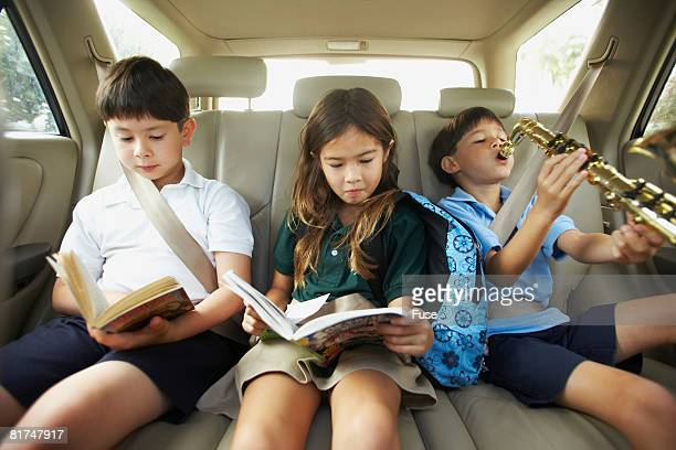 Kids Riding in the Back Seat of a Car