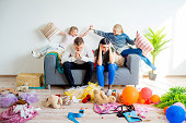 Kids romping at home creating a mess parents are stressed