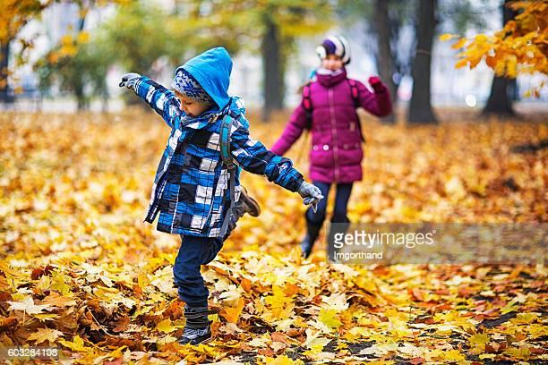 Kids running in an autumn park
