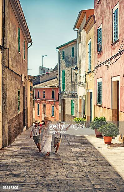 Kids running in beautiful mediterranean town.