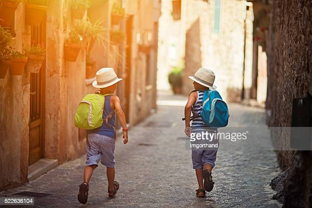 Kids running in mediterranean street.