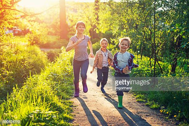 Kids running on a forest path.