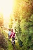 Kids running on a secret garden path.