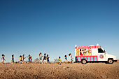 Kids running to ice cream truck,  Nevada Deser