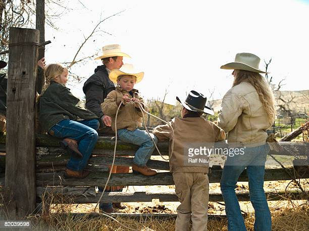 Kids sitting on fence