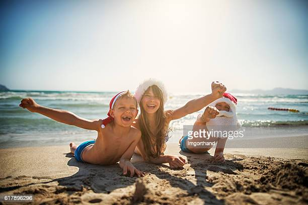 Kids spending christmas on the beach