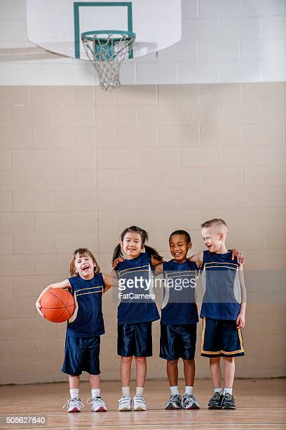 Kids Standing Together Before a Basketball Game