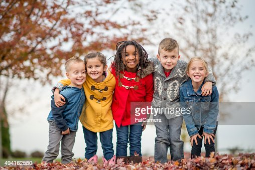 Kids Standing Together in a Row at the Park