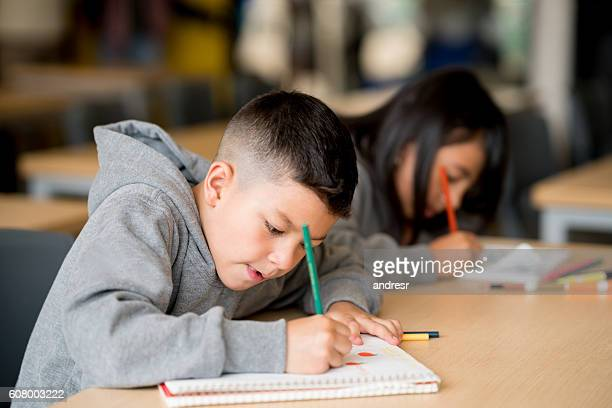 Kids studying at the school