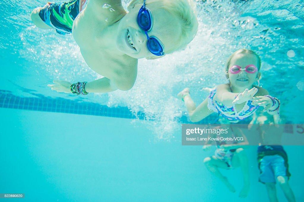 kids 6 9 swimming underwater stock photo - Kids Swimming Underwater