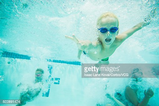 Kids Swimming Underwater kids swimming underwater stock photo | getty images