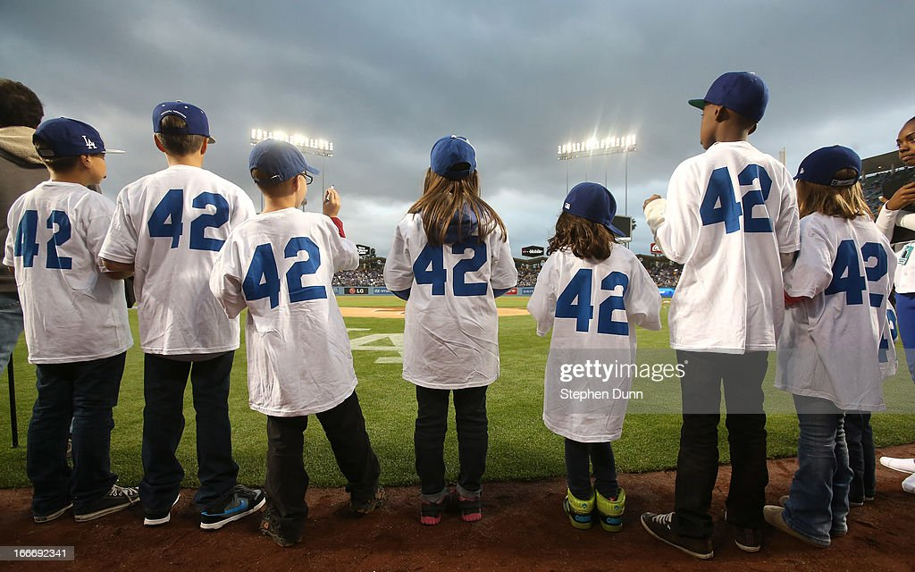 Kids taking part in Jackie Robinson Day ceremonies wear jerseys with the number 42 before the game between the San Diego Padres and the Los Angeles Dodgers at Dodger Stadium on April 15, 2013 in Los Angeles, California. All uniformed team members are wearing jersey number 42 in honor of Jackie Robinson Day.