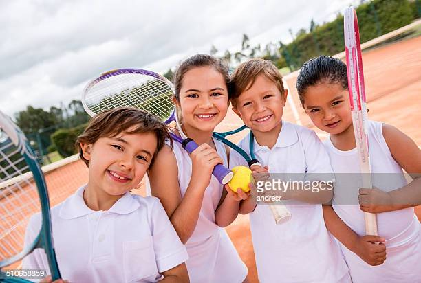 Kids taking tennis lessons