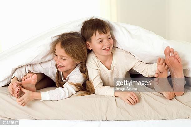 Kids tickling parents' feet