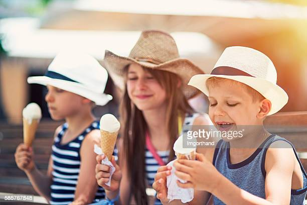 Kids tourists eating ice cream