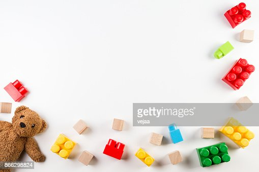 Kids toys background with teddy bear and colorful blocks : Stock Photo