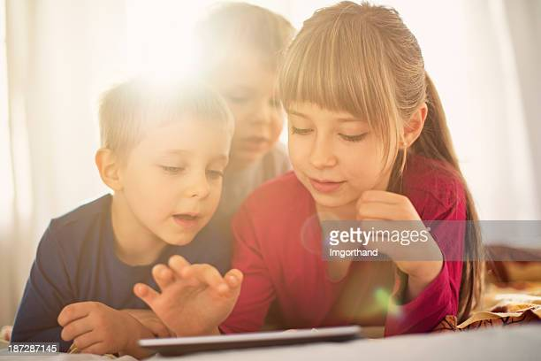 Kids using digital tablet