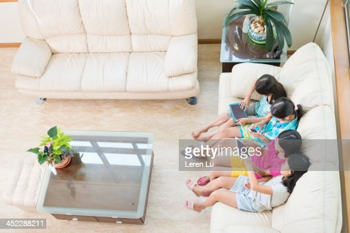 Kids using digital tablets and smartphone : Stock Photo