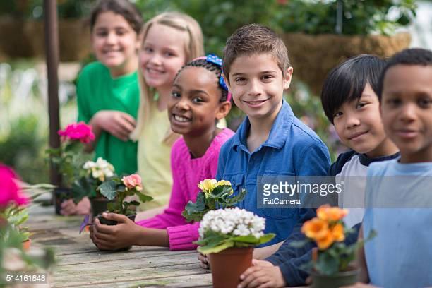 Kids Volunteering at a Nursery