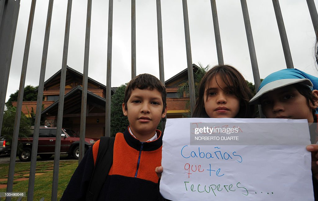 Kids wait for a chance to see Paraguayan striker Salvador Cabañas, outside his home in Asuncion on May 24, 2010. Cabañas, striker of Mexico's Club America and Paraguay's top scorer in the South Africa 2010 World Cup qualifiers with six goals, is on the road to recovery after being shot in the head in a Mexico City bar last January and will not be fit in time for South Africa. AFP PHOTO/Norberto DUARTE