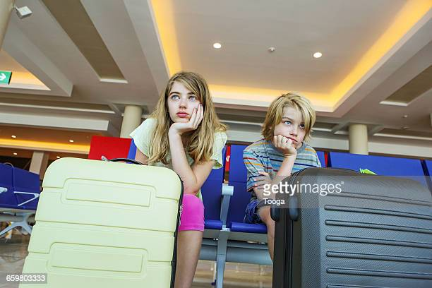 Kids waiting for flight in airport