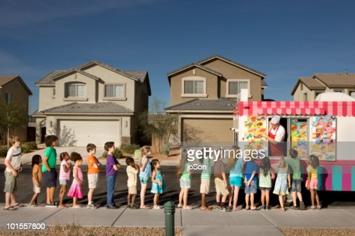 Kids waiting in line for ice-cream : Stock Photo