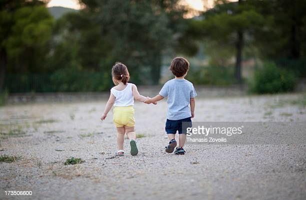 Kids walking alone in a park