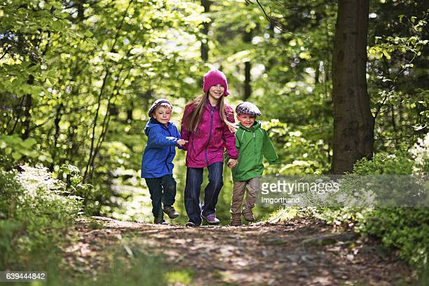 Kids walking in spring forest