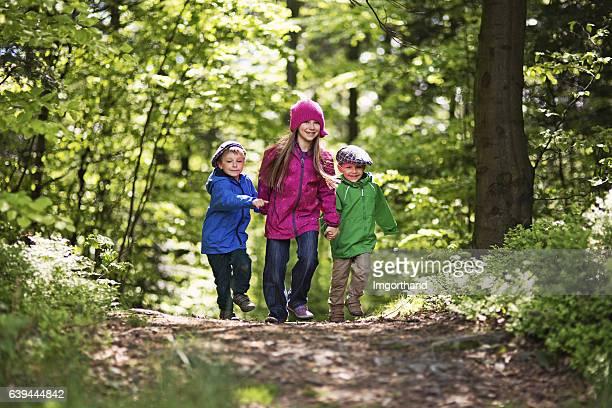 Kids walking in spring forest