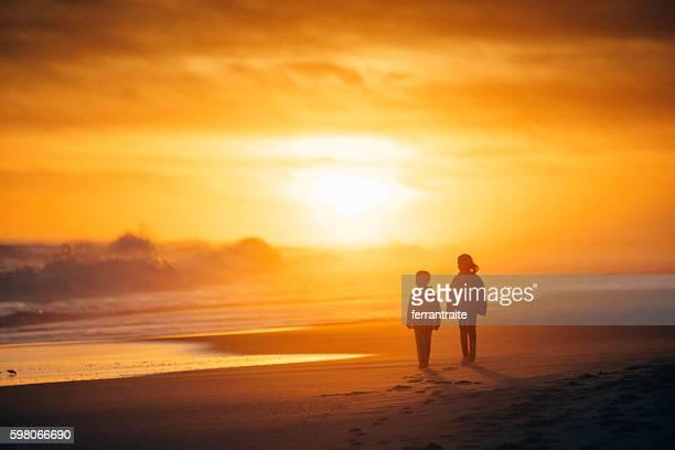 Kids walking towards the sun
