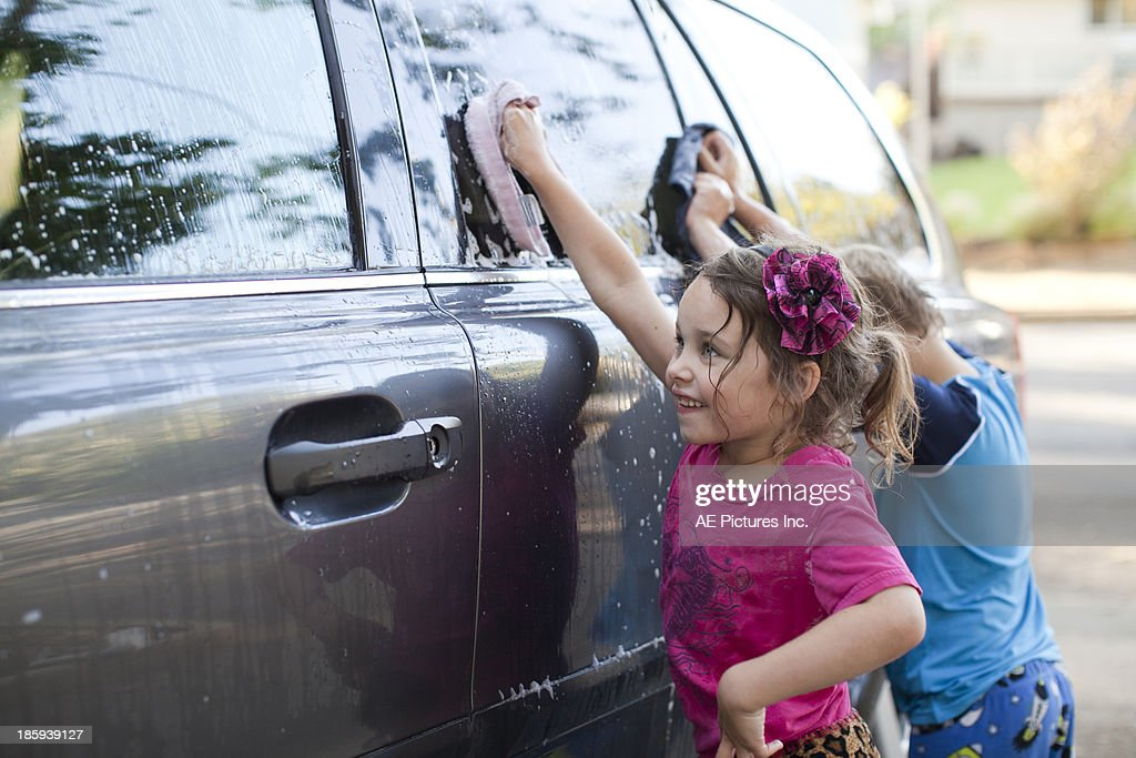 Kids washing the car : Stock Photo