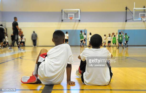 Kids watch and play basketball at Russell Westbrook 5th Annual Why Not Foundation Basketball Camp at Jesse Owens Community Regional Park on July 25...