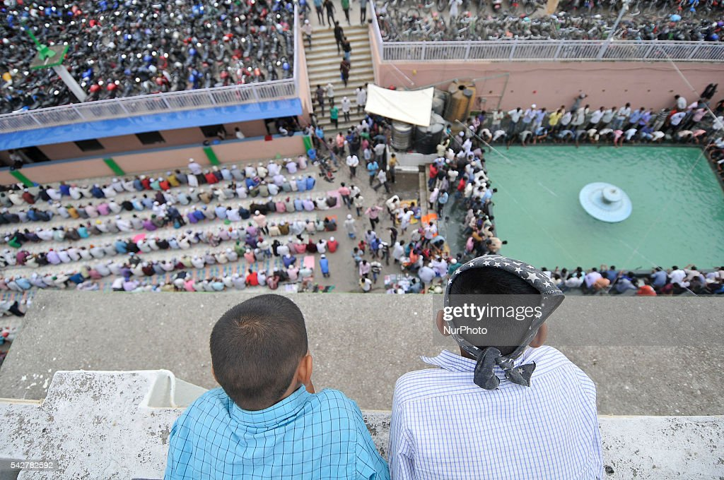 Kids watching from top roof as Nepalese Muslim ready to offer ritual prayer at Kashmari Jame mosque on the third Friday of Ramadan (also known as Ramadhan or Ramzan) on June 24, 2016 at Kathmandu, Nepal. Ramadan (also known as Ramadhan or Ramzan) is the ninth month in the Islamic calendar. During the month of Ramadan; Muslims fast from dawn to dusk all over the world. While fasting from dawn until sunset; Muslims avoid from consuming food; drinking liquids; smoking; and engaging in sexual relations.