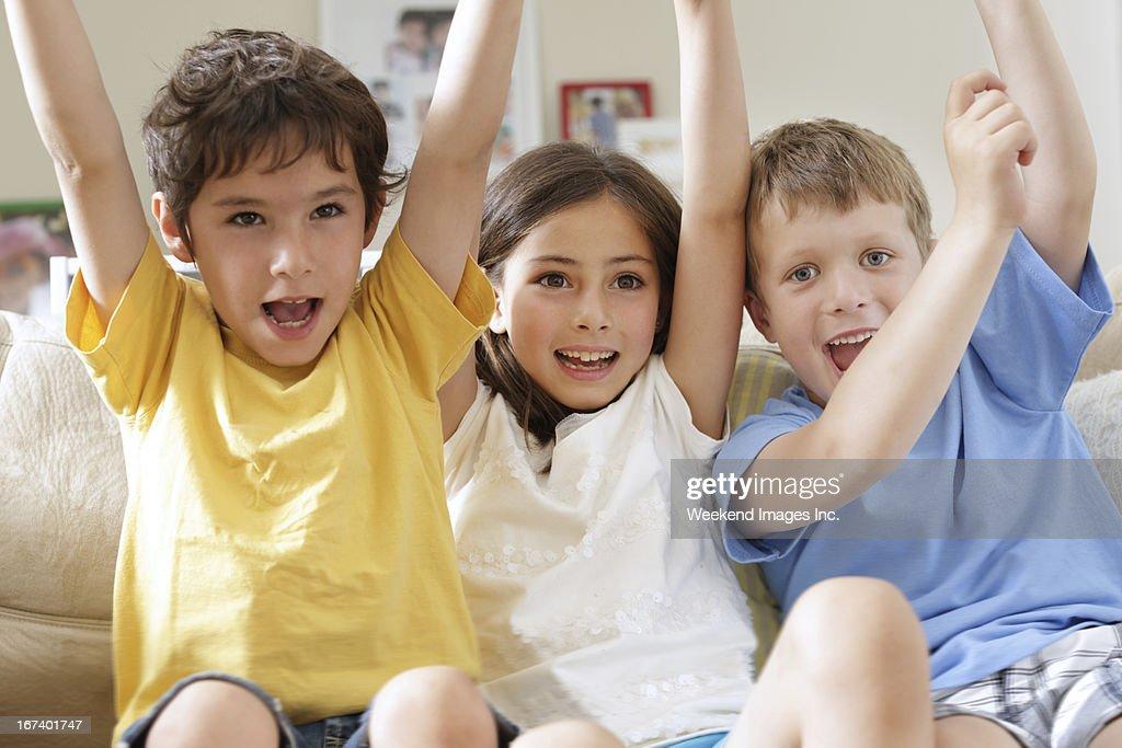 Kids watching TV : Stock Photo
