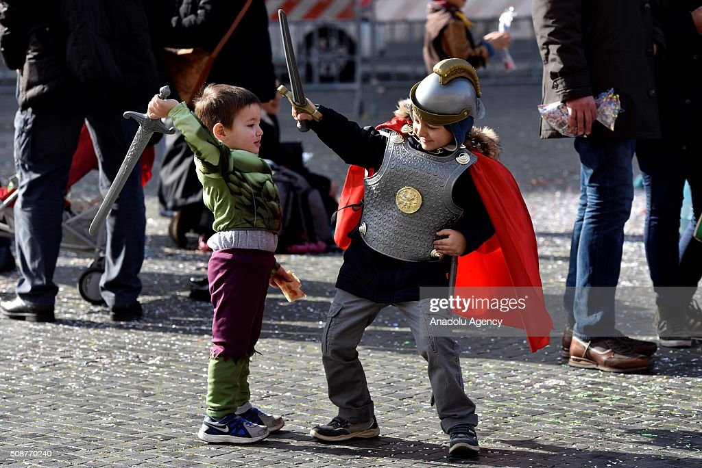Kids wearing costumes play with swords at the Piazza Navona, one of the tourist area of the city, during a carnival, which is held every year on February, in Rome, Italy on February 6, 2016.