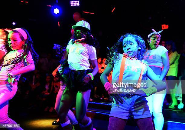 Kids wearing Halloween costumes and makeups dance during an electronic dance music party organized by CirKiz at a night club in New York on October...