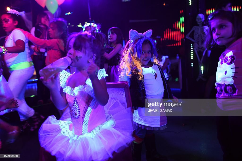 kids wearing halloween costumes and makeups dance during an electronic dance music party organized by cirkiz