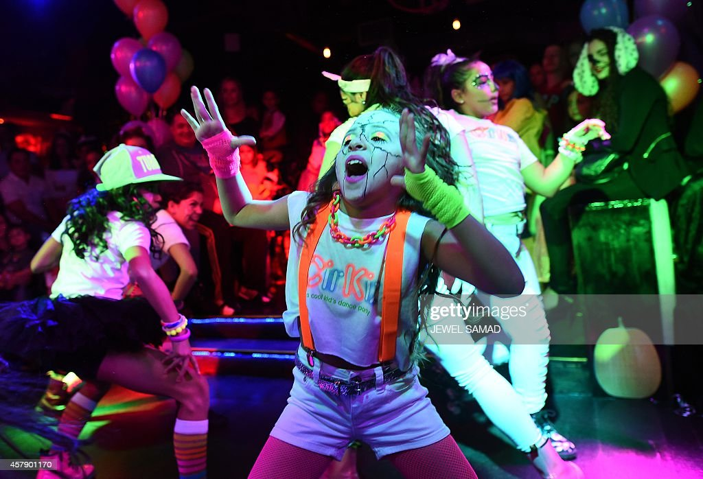 kids wearing halloween costumes dance during an electronic dance music party organized by cirkiz at a