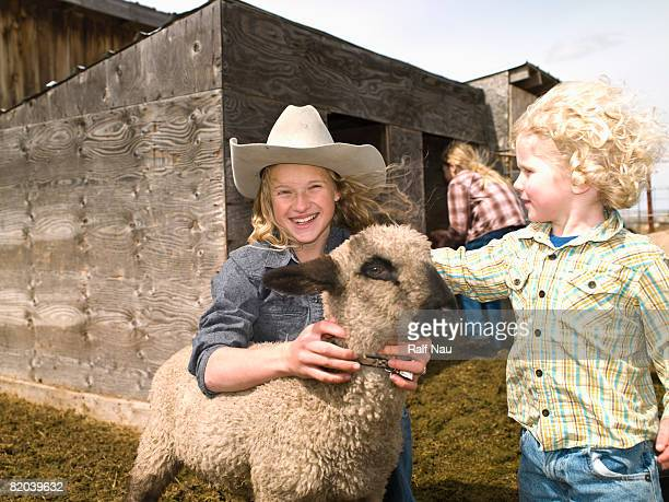 Kids with 4-H lamb