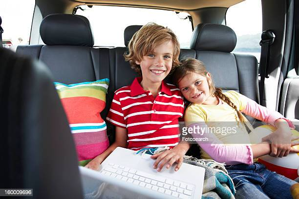 Kids with a computer in a car