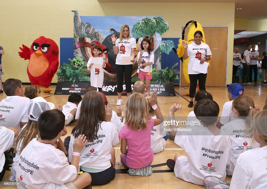 Kids With Heart Ambassador Michael Elhers Olympian Chloe Sutton and AHA Kids With Heart Ambassador Grace Elhers join in a health pledge at The Angry...